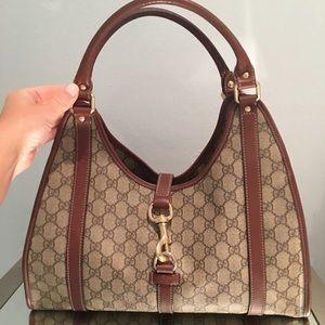 Authentic Gucci monogram leather bag
